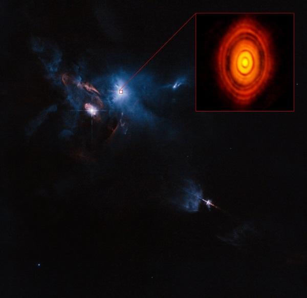 На изображении показано местоположении звезды HL Tau 76 в туманности