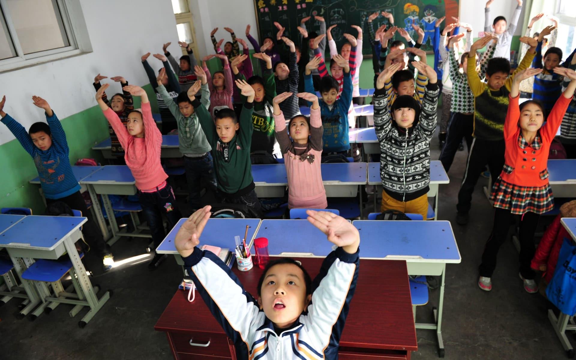 Невнимательных учеников в китайских школах начинают «ловить» при помощи системы распознавания лиц - 1