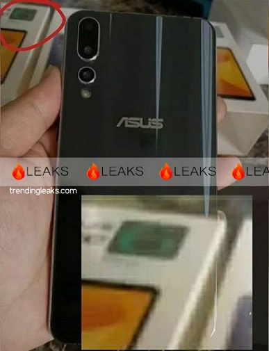 Серийный вариант смартфона Asus Zenfone 6 c градиентной тыльной панелью позирует на фото