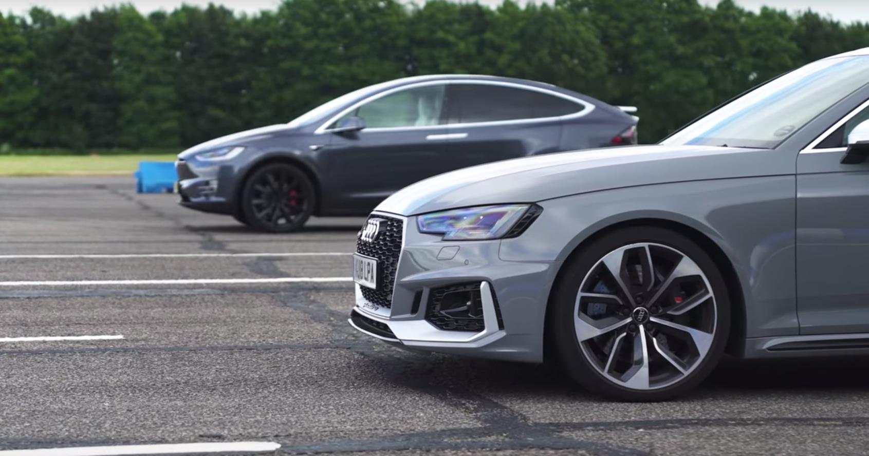 Audi RS4 выставили против Tesla Model X