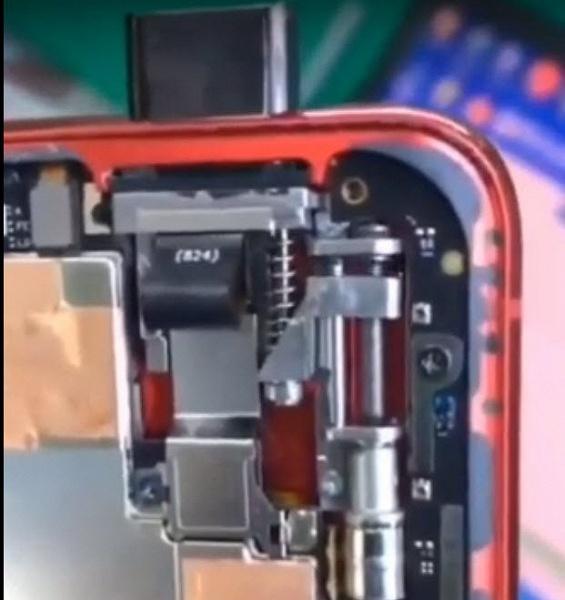 Флагман Redmi 855 без задней панели и механизм его выдвижной камеры