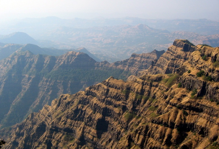 Ground view of mountains sculpted out of the Deccan Plateau