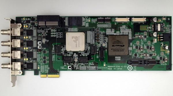 Одновременно стала доступна плата для разработчиков MB86M31-EVB