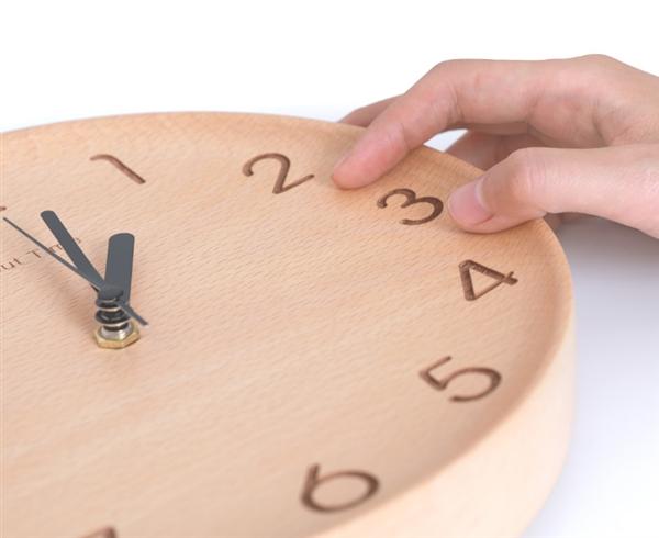 Xiaomi выпустила деревянные настенные часы за $31