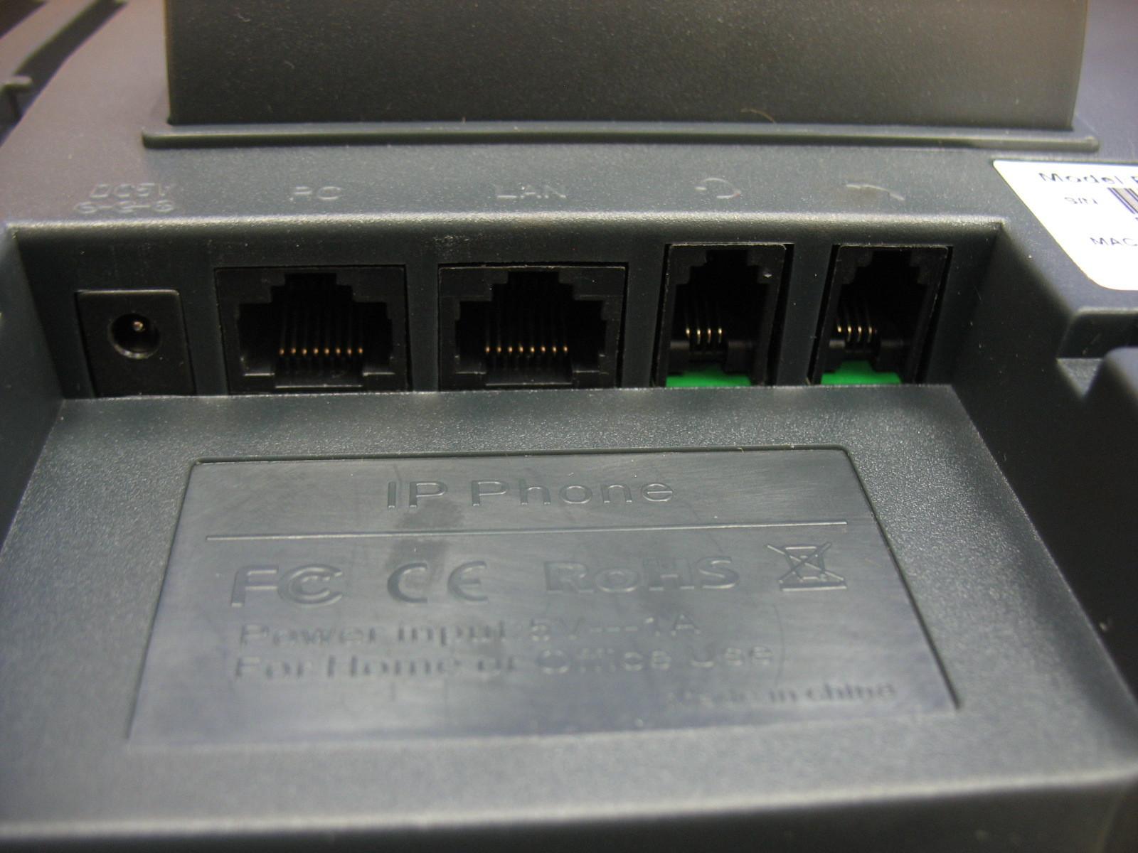 Интерфейсы и разъемы телефона вид сбоку.